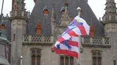 Bruges flag waving in front of Provinciaal Hof in Bruges Stock Footage