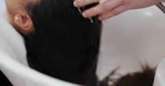 Young woman in a hairdressers shop. Shot on RED Epic. Stock Footage