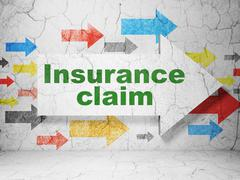 Stock Illustration of Insurance concept: arrow with Insurance Claim on grunge wall background