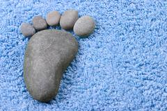Foot symbol on terry towel - stock photo