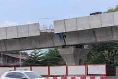 Expressway bridge over the road under construction. Stock Photos