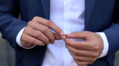 Man turns the ring on the finger Stock Footage