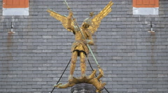 Golden statue of a soldier with wings killing a dragon on Provinciaal Hof Stock Footage