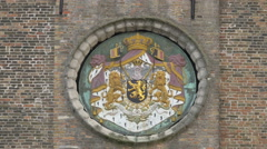 Royal seal on the front of the Belfry, Bruges Stock Footage