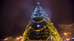 Christmass tree with garland at evening city Stock Footage