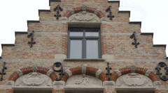 Old building with beautiful arches and ornaments at Tom Tailor store, Bruges Stock Footage