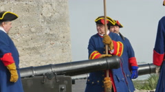 Stock Video Footage of St Augustine FL -Reenactment of Cannon Being Cleaned Fort Castillo
