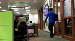 One side of people ending meeting and leaving TD bank Stock Footage