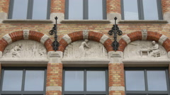 Sculptures on a beautiful building located on Zuidzandstraat, Bruges Stock Footage