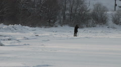 The fisherman on winter fishing in frosty day - stock footage