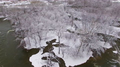 Aerial view of river rapids and wilderness landscape after blizzard snowfall Stock Footage