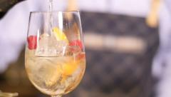 Bartender pouring sparkling wine into exotic drink, slowmotion footage - stock footage