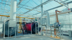 Modern boiler room equipment for heating system. Pipelines, water pump, valves - stock footage