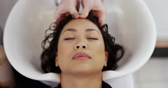 Woman getting her hair washed by a hairdresser at a salon. Shot on RED Epic. Stock Footage