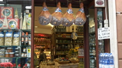 entrance to a delicatessen in rome with hams - stock footage