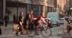 Anonymous crowd of people walking cycling bicycles commuters London City street Stock Footage