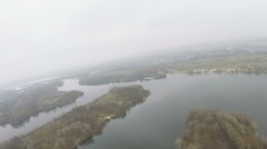 Flight over  field, lake, river in foggy autumn day. Aerial Stock Footage