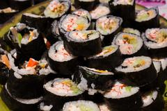 Lots of home made sushi - stock photo