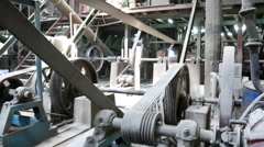 joint of old machine working by water steam engine in agricultural factory - stock footage