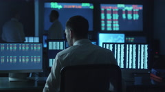 Stockbroker spotted a positive trend in trading charts while working in office Stock Footage