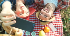 Picnic concept with vegetarian couple in park outdoor Stock Footage