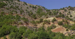 A car and truck winding its way up a steep road, Dinosaur National Monument Stock Footage