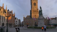 Beautiful view of the Belfry and buildings seen in sunlight in Markt, Bruges Stock Footage