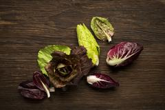 Red Radicchio Salad on wooden table. Stock Photos