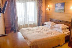 Double Bed in a wooden house Stock Photos