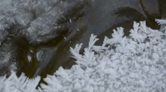 Closer look of the white snowflakes on the rock Stock Footage