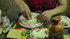 Closeup of woman hands preparing, and decorated with vegetable salad - stock footage
