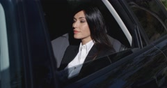 Beautiful young executive sitting in limousine - stock footage