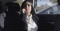 Interior view of woman on phone in limousine - stock footage