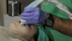 Body care, cleaning face in beauty salon, beautician, facial cleansing, tilt up. Stock Footage