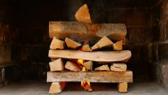 Starting fire to a pile of wood - stock footage