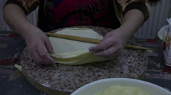Closeup of a woman in the kitchen preparing cookie dough Stock Footage