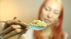 Fresh Green Sprouts Buckwheat closeup. Woman with Sprouts Buckwheat. Raw Healthy - stock footage