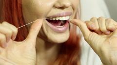 Woman and teeth floss  Stock Footage