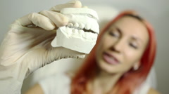 Dental Casting - Beautiful girl holding dental gypsum models Stock Footage