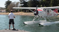 Sea plane docking in bay Stock Footage