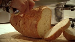 Cutting bread on the table. Food in Italy. Stock Footage