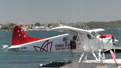 Sea plane docked at a bay Stock Footage