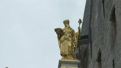 Golden statue of a priest on Oude Civiele Griffie in Bruges Stock Footage