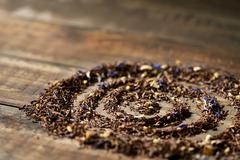 rooibos mixed with flowers, dry fruits and herbs - stock photo
