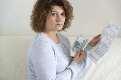 Adult woman with receipts and Russian money Stock Photos