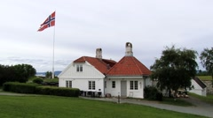 Norwegian National flag waving at the historical building  in Trondheim, Norway. Stock Footage