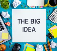 The big idea. Text words advice on office table desk with supplies, white blank - stock photo