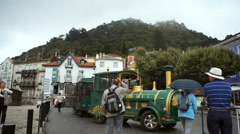 Tourist tour train in mountain town, Sintra city center, Portugal Stock Footage