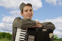 Portrait of Soviet soldier with accordion Stock Photos