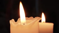 Two white candles, thick burning. The first candle is melted by the flame 11 Stock Footage